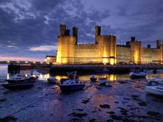 Wales, United Kingdom Photos - National Geographic. Caernarfon Castle whose construction began in 1283 by Edward I located in northern Wales.  In 1969 it was the site of the investiture of Prince Charles as Prince of Wales.
