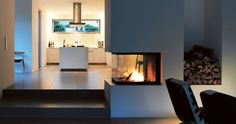 Home in Munich with a bulthaup b3 kitchen.  I also like the non-traditional location of the fireplace.