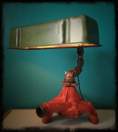 Coolest desk lamp ever, made with salvaged car parts & the best part? It rotates all around! Car Part Furniture, Automotive Furniture, Automotive Decor, Furniture Design, Furniture Plans, Kids Furniture, Bedroom Furniture, Furniture Chairs, Garden Furniture