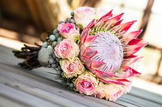 Photo about A king protea and detailed rose bouquet resting on a wooden deck. Image of deck, bouquet, flower - 33948186 Protea Bouquet, Broach Bouquet, Crystal Bouquet, Protea Flower, Bride Flowers, Bride Bouquets, Wedding Flowers, Modern Flower Arrangements, Wedding Arrangements