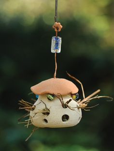 Holds nesting materials for birds...it would be fun to watch.