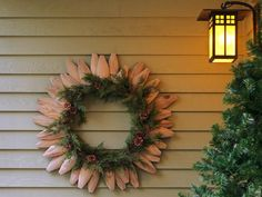 Learn how to make a wreath from picket fence pieces and a strand of garland with these instructions from DIYNetwork.com.