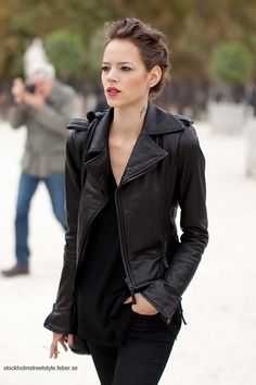 chic leather jacket and pulled back hair