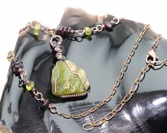 Peridot helps release old negative patterns you have been accustomed to, including negative beliefs about yourself. It is a tool for bringing your physical reality into alignment with your inner truth. It cleanses the aura and is especially useful to healers because of its connection to Nature's healing energies and spirits. #peridot #garnet #peridotnecklace #peridotjewelry #garnetjewelry #rawperidot #peridotpendant #rawcrystaljewelry #crystalhealing #metaphysicalhealing #healingproperties Raw Gemstone Jewelry, Raw Crystal Jewelry, Garnet Jewelry, Gems Jewelry, Boho Jewelry, Garnet Pendant, Crystal Pendant, Peridot Necklace, Pendant Necklace