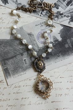 The Madonna's Love-Vintage assemblage necklace by frenchfeatherdesigns