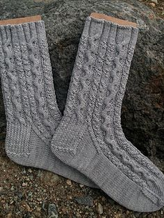 Christine Pike's House of Greyjoy socks are available for free on Ravelry! These cabled socks are knit with our La Jolla yarn and inspired by Game of Thrones!