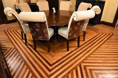 Formal dining room with floor pattern of alternating oak and mahogany boards.