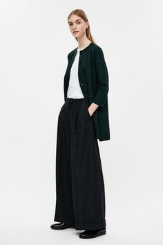 An A-line shape, this long cardigan is made from a stretchy jacquard knit with a…