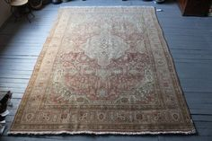 VINTAGE LADIK RUG  Place of Origin: Konya- Anatolia  Pattern: Floral Age: Over 50  Materials Used: %100 natural handspun yarn with natural colored wool.  Size: 237x335(cm) / 93x132 (inch) / 78x11 ft Shop Code: C002580  Condition: Professionally cleaned and ready for use!    Shipping: FedEx