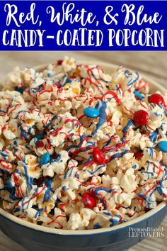 This Patriotic Candy Coated Popcorn recipe is made by topping salted popcorn with red, white, and blue melted candy coating and red and blue M&Ms. Such an easy no-bake treat for 4th of July!