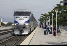Amtrak's San Luis Obispo bound Pacific Surfliner pulls to a station stop in Van Nuys CA, where it will pick up a nice compliment of additional riders.