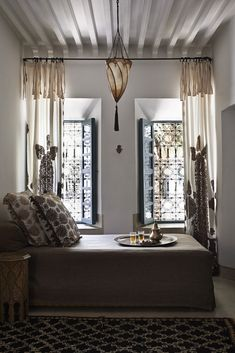 Neutral Moroccan bedroom with lots of patterns Moroccan Room, Modern Moroccan, Moroccan Interiors, Moroccan Design, Moroccan Decor, Moroccan Style, Moroccan Lanterns, Marrakech, Light Hardwood Floors