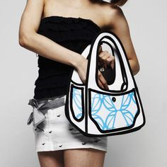 2-D cartoon purse.. This is so confusing, my mind is hiding in a corner. But I think I like it.