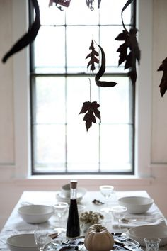 Halloween table with Black Leaves, leaf silhouettes, by Justine Hand for Remodelista