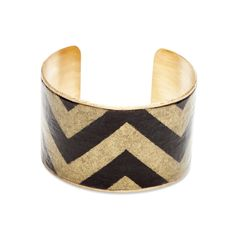 """Love this! Found it on BJsBoutiqueWe've melded a classic with the Belinda Cuff - vintage chevron print and goldtone metal meet for the ultimate arm party.  - Vintage paper, antiqued brass, resin  - 1 1/2"""" wide  - Adjustable fit"""