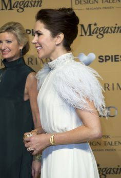Crown Princess Mary glammed it up with feathers on her shoulders for the design competition Danish Design Talent - Magasin Award.
