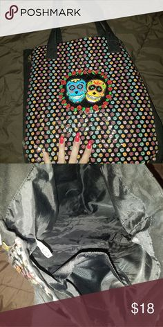 American Studio LG tote Colorful Sugar skull front, solid black on the backside ,straps & inside,with inner pocket, no rips,tears. Great condition. american studio Bags Totes