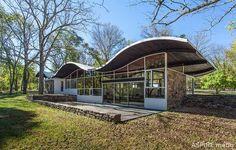 Mid-Century Modern | Undulating double conoid roof.