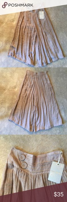 Urban Mango gaucho pants skirt Sweet soft polyester fabric with a subtle plaid texture. Wide waistband with stitching details and fabric covered buttons. Elastic back waist. New with tags Urban Outfitters Skirts