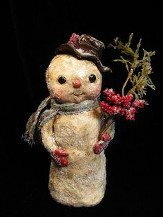 """Precious little snow person:This 8"""" tall snowman was sculpted from polymer clay over a foil armature. He was painted, then 'antiqued' and doused in german glass glitter."""