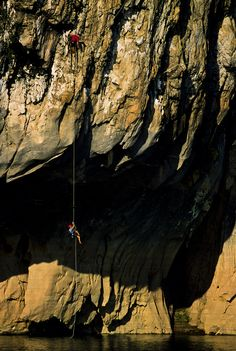 Jose Pereyra ascends rope above Nam Ou River, Laos