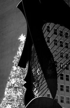 Chicago's Picasso sculpture is silhouetted against Daley Plaza Christmas tree 2007.