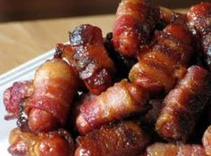 """Bacon Cocktail Weenies: """"These were fantastic. Everyone loved them. I think good bacon makes a big difference. I used uncured maple bacon. And I ended up mixing light and dark brown sugar, which makes them almost candy-coated. Think Food, I Love Food, Bacon Wrapped Lil Smokies, Bacon Wrapped Sausages, Cocktail Weenies, Cocktail Sausages, Pig Candy, Sugar Candy, Snacks Für Party"""
