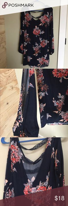 Spring Dress Spring Dress with cute lace back. Long sleeves with open slit that exposes arm. Super Cute!! Worn once. Navy blue with pinks. Xhilaration Dresses Mini