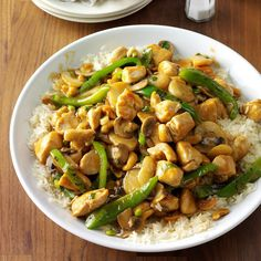 Cashew Chicken with Ginger Recipe -There are lots of recipes for cashew chicken, but my family thinks this one stands alone. We love the flavor from the fresh ginger and the crunch of the cashews. Another plus is it's easy to prepare. —Oma Rollison, El Cajon, California