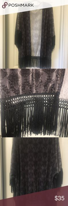 NWOT TORRID black and gray kimono type wrap BRAND NEW WITHOUT TAGS TORRID (size 2/3) gray with black print and fringe kimono type cover up. It's silly smooth and the fringe is ornately designed and draped.  This kimono has never been worn. TORRID Jackets & Coats Capes