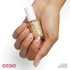 """it's getting groovy with nail art featuring our winter 2016 collection step 1: after a thin layer of essie base coat, apply two coats of oh behave! step 2: using a striping brush, create rounded rectangle shapes on the corners of each nail using go with the flowy. step 3: create accents and highlights with getting groovy. step 4: add """"starburst"""" shapes with getting groovy & go with the flowy, then seal with essie top coat."""