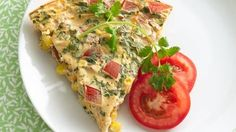 Chock-full of tomatoes, corn and Cheddar, this crustless quiche made with soymilk is oven-ready in minutes - cook longer about an hour, also add black beans and green onions Vegetarian Recipes, Cooking Recipes, Healthy Recipes, Corn Recipes, Recipies, Healthy Foods, Breakfast Dishes, Breakfast Recipes, Breakfast Pie