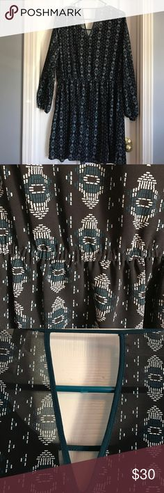 Black and blue tribal printed dress - size XL Black and blue tribal printed dress - never worn. Has an elasticized band and banded sleeves. Very pretty! Xhilaration Dresses Midi