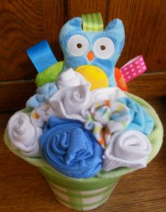 Gift baskets cupcakes sugar cookies muffins oat chocolate owl baby bouquet on etsy baby clothes are rolled up to look like flowers and negle Images