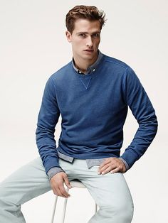 British model Tom Warren claims modern basics for Jaeger's summer 2015 campaign. Photographed by Karim Sadli for the in-studio images, Tom is pictured in gray and blue as he brushes up on smart staples that include the gray suit and casual pullover. Related