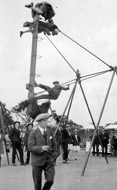 Daredevils: With adults watching on, these children are almost upside down on the swings.