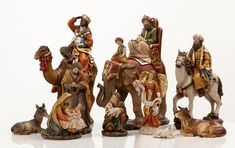 """Heaven's Majesty 11 Piece Nativity Figure Set with Kings on Animals!  Wood carved look, hand-painted in traditional colors. Beautiful 11 piece heirloom quality nativity set with removable Baby Jesus! You will not find this incredibly unique set anywhere else. 6"""" scale figures, tallest king on elephant measures 9"""" tall; beautifully hand-painted resin figures   give the look of actual hand carved wood. Stunning! (Item #22539) $125.00"""
