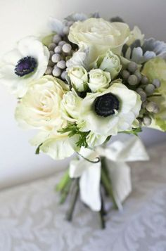 ideal combination of anemone, brunia, ranunculus and spray roses. would include more foliage; senecio and eucalyptus.