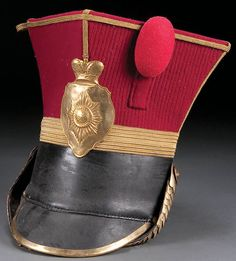 AN IMPERIAL RUSSIAN-STYLE OFFICERS SHAKO, probably 20th century, the leather and cloth body trimmed in bullion and brass, the front set with shield-form plate with crown and with brass chin scales.