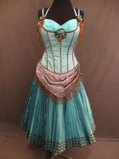 Saloon Girl Gown 1880, turquoise bronze.    David, thought you might like to see this.  I like the idea of shorter skirts and such to make the saloon girls more flirty.  Sound good to you?