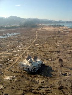 'Surviving a big wave and still stand strong' After Tsunami in Aceh on 26th December 2004. every building destroyed except a mosque and this is ONE of the mosque that still stand...