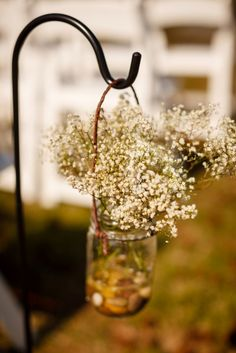 Baby's breath in mason jars for wedding ceremony decorations from Alex & Jim's small budget, DIY rustic meets modern Northern Virginia wedding. Images by Stephen Gosling Photography.
