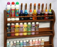 Repurposed Spice Rack into paint storage ~ paint a fun color and rough up for shabby cute storage!