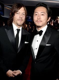 Norman Reedus and Steven Yeun attend AMC's 'The Walking Dead' season 6  fan premiere event at Madison Square Garden on October 9, 2015