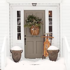 """A little Winter Front Door Inspiration...sometimes ""simple""does it. In love with the putty gray door color. @countrylivingmag #connecticutchristmas"""