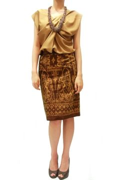 Our famed pencil skirt meticulously shaped and seamed to figure-flattering perfection dressed in a fluid ikat. Beautifully crafted in textured cotton with a hint of stretch for comfort. Sits just above hip and back zip.         Worn with Twist Front Top in Camel    Get this look only at www.shopatnoona.com