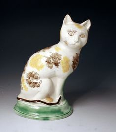 """Seated Cat. Yellow, Brown & White Cat on a Base. Circa 1780. 8-1/2""""."""