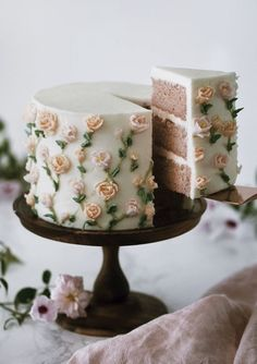 A moist strawberry cake with a kiss of lemon covered in delicate buttercream flowers. - Tasty - A moist strawberry cake with a kiss of lemon covered in delicate buttercream flowers. Pretty Birthday Cakes, Pretty Cakes, Cute Cakes, Beautiful Cakes, Amazing Cakes, Cake Birthday, Flower Birthday Cakes, Birtday Cake, Fancy Cakes