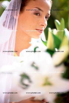 http://www.photaki.com/picture-bride-holding-bouquet_1323421.htm