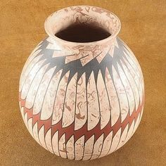 On this lovely, handcrafted Mata Ortiz Olla pot are simple graphics in warm black, accented with Terracotta pigmented paint for just the right pop of color. The simple, hand painted graphics recede so that the pot explodes with the swirling colors of the Marbled Terracotta & Beige clay. $144.00 #Alltribes